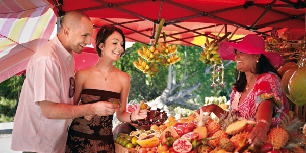 Happy couple at a market in Reunion Island
