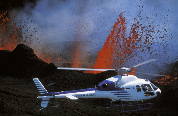 Helicopter flying over active Reunion volcano